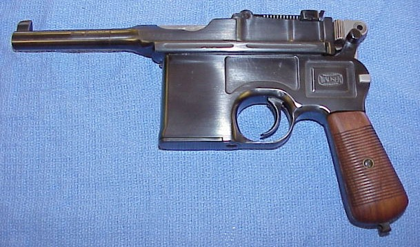 Cuando los armeros se anticipan Mauser%20c%2096%20repoli%20et%20rechambre%209mm-01